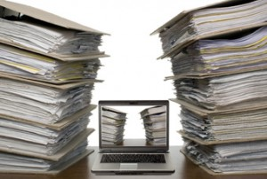 Blue Mountain Data Systems - photo of documents and laptop