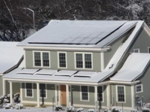 Despite a harsh winter that left the Net-Zero Energy Residential Test Facility's photovoltaic and solar thermal panels covered with snow on 38 days, the energy-efficient house produced more energy than it used over the course of a year. Image Credit: NIST