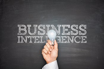 Business intelligence concept on blackboard with light bulb